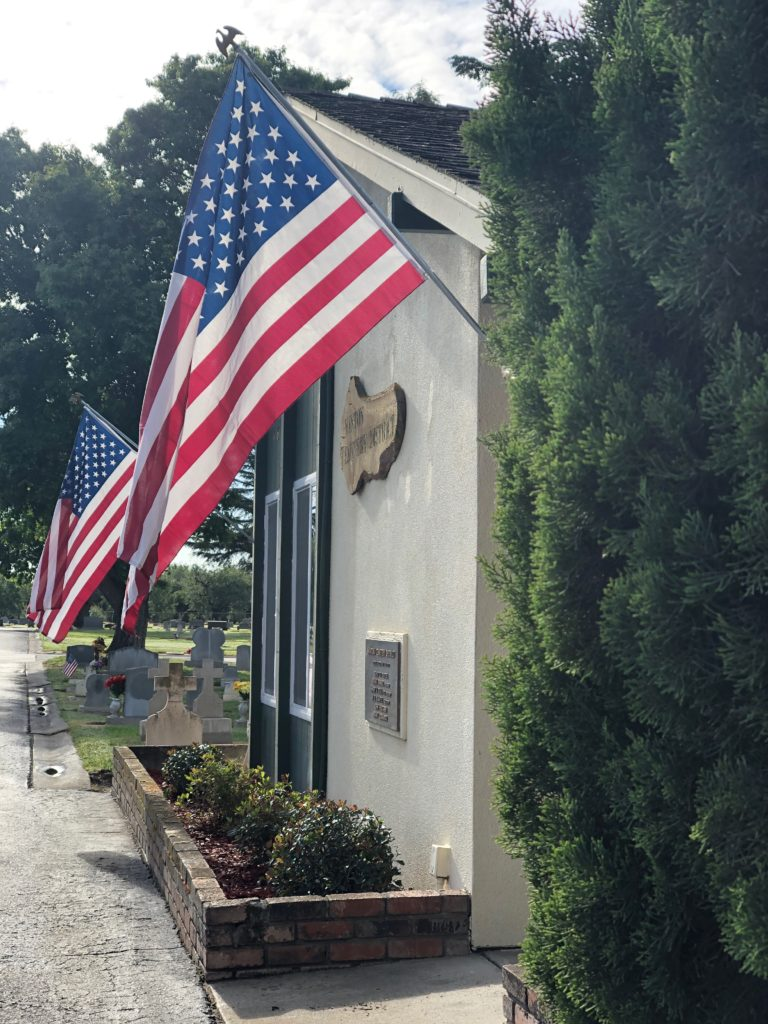 main office for Winton Cemetery with 2 American flags flying